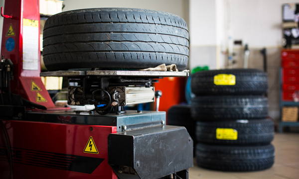 Inside a garage - changing wheels/tires (shallow DOF; color tone